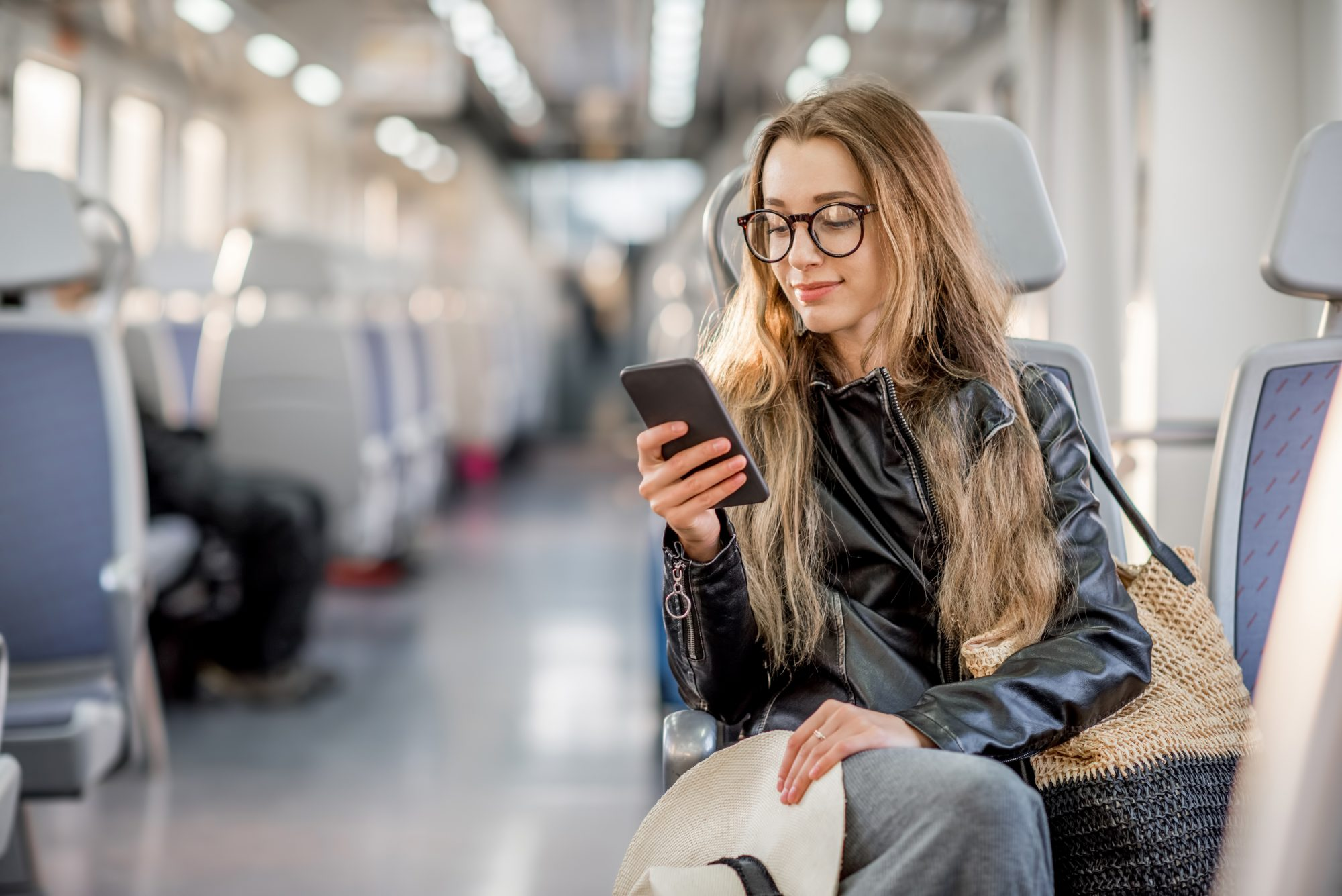 Woman on subway on her phone.